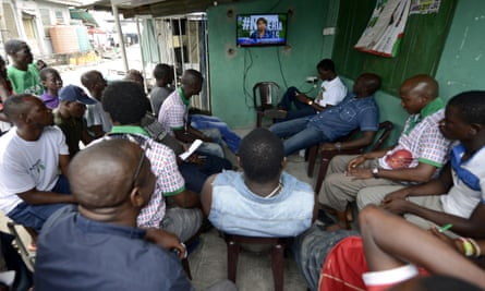 People watching television in Lagos.