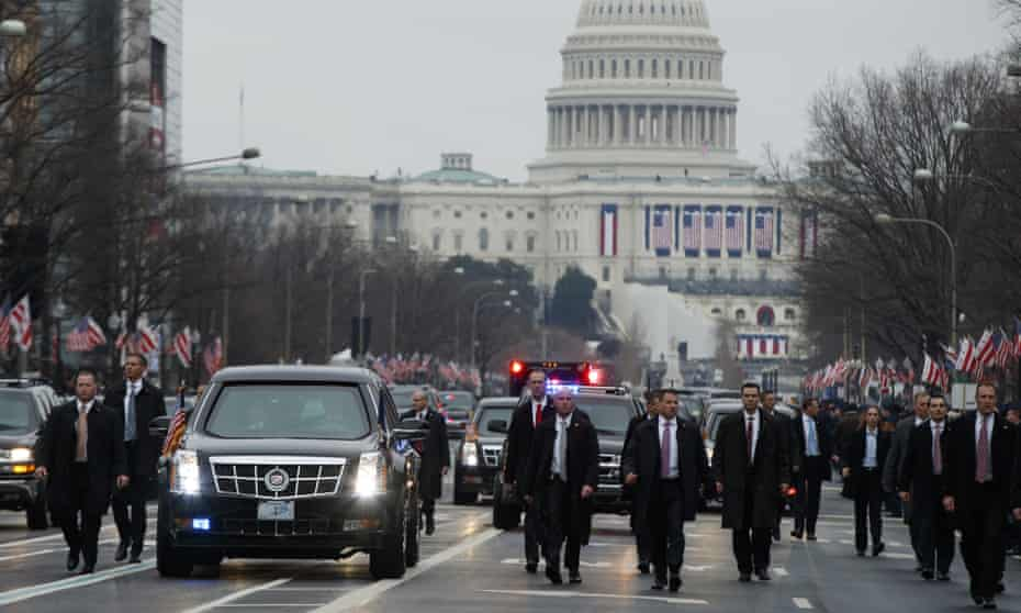 Secret Service agents escort President Donald Trump's car in Washington DC.