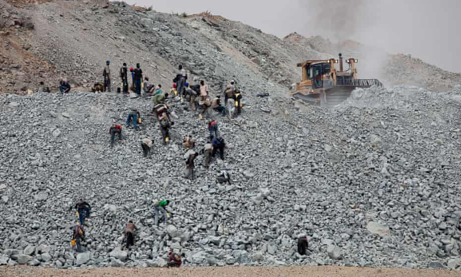 Villagers search for pieces of gold contained in discarded waste rock from the North Mara mine.