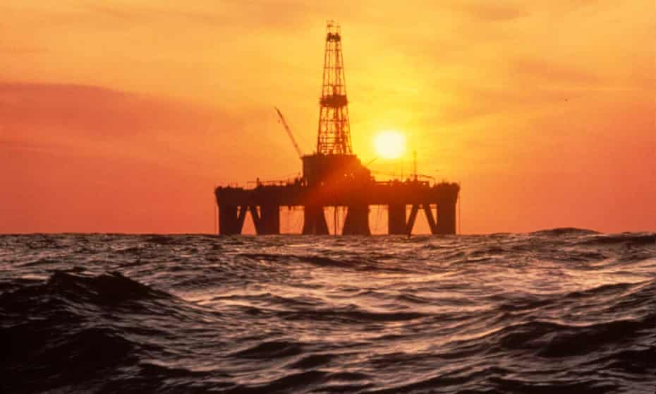 Offshore drilling rig with sunset
