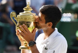 Djokovic kisses the trophy for the fourth time.