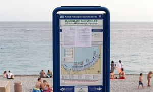 A sign at Ponchettes beach in Nice shows the law forbidding the wearing of clothing such as the burkini