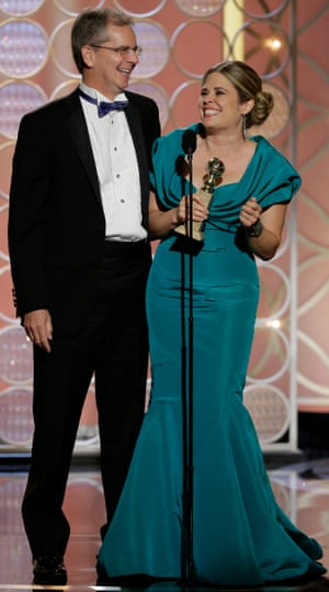 Frozen co-directors Chris Buck and Jennifer Lee accept the Golden Globe award for Best Animated Feature Film on January 12 2014 in Beverly Hills, California