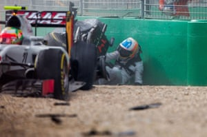 Somehow the two-time World Champion is able to crawl free of the wreckage unassisted.