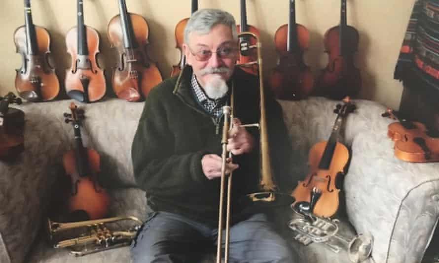 Michael Gerard at home with some of his many musical instruments