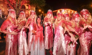 People attend the West Hollywood Halloween costume carnival on Santa Monica Boulevard in Los Angeles