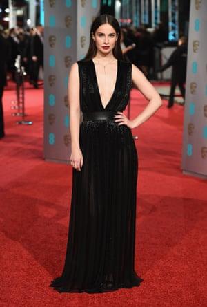 Icelandic actress Heida Reed in a V-neck black belted dress.