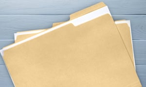 Document folders on wooden background