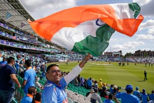 An Indian fan waves a flag before the Cricket World Cup match between India and Australia at the Oval