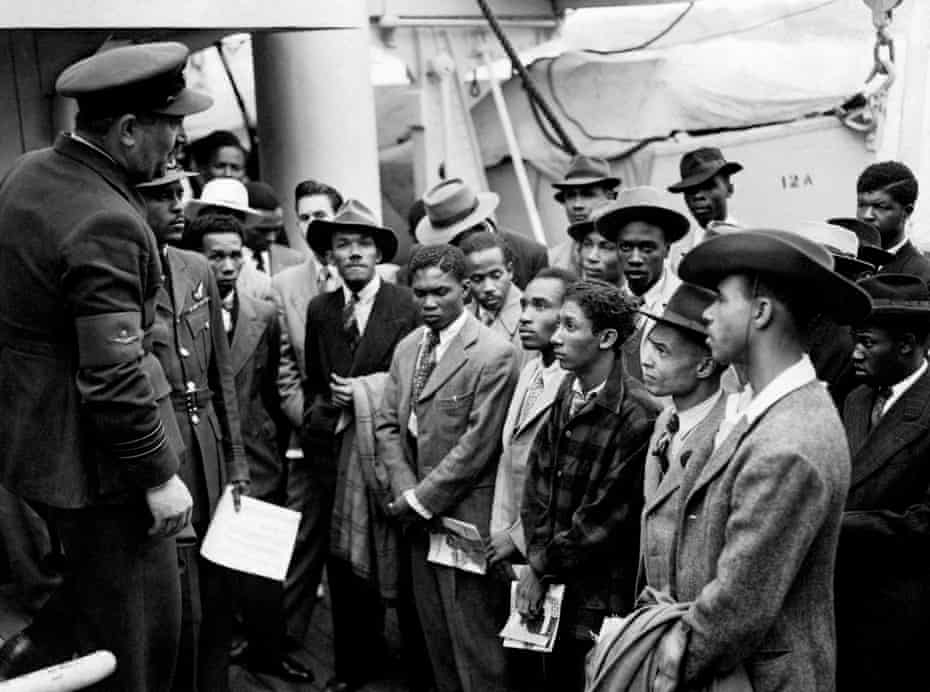 Jamaican immigrants being welcomed by RAF officials from the Colonial Office after the ex-troopship HMT Empire Windrush landed them at Tilbury.