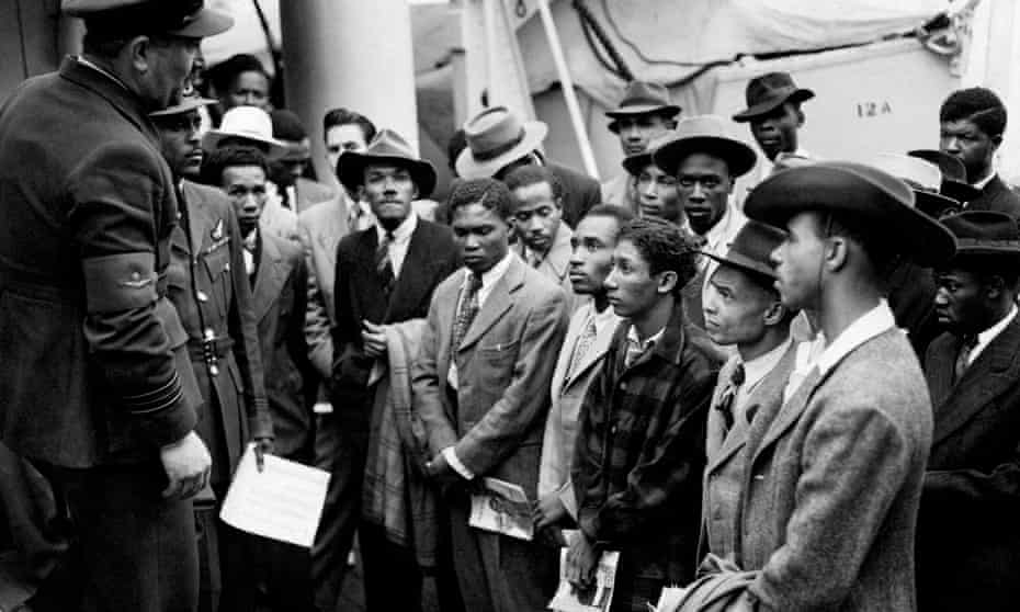 Jamaican immigrants being addressed shortly after their arrival in Tilbury by RAF officials from the Colonial Office in 1948.