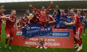 Middlesbrough players celebrate their promotion to the Premier League after drawing with Brighton.