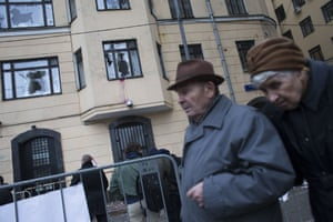 An elderly couple walk past the Turkish embassy in Moscow