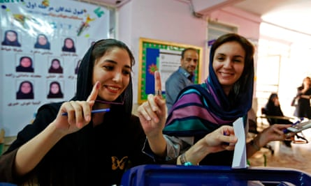 Iranian women cast their ballots at a polling station at the Lorzadeh mosque in southern Tehran