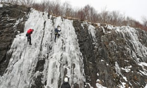 People climb an icy slope near Tebay in Cumbria