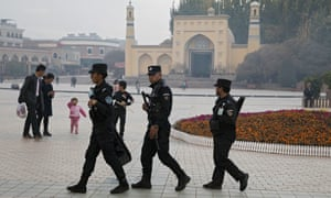 Uighur security personnel patrol near the Id Kah Mosque in Kashgar in western China's Xinjiang region