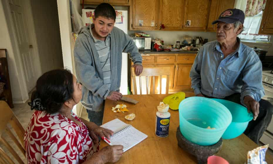 Guillermo, Theresa and Emillio's son, counts the day's earnings with his parents