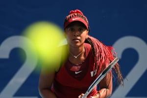 Tokyo, Japan: Naomi Osaka prepares to hit a return during the Olympics tennis first round match against Zheng Saisai of China