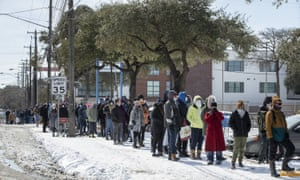 People wait in a long line to buy groceries during an extreme cold snap and widespread power outage on 16 February 2021, in Austin, Texas.