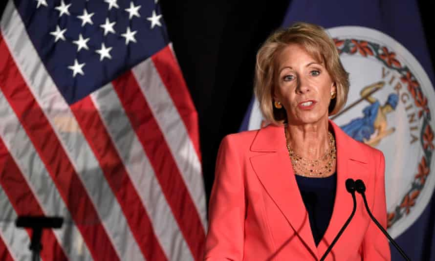 Betsy DeVos has faced criticism for delaying consideration of over 65,000 applications for loan forgiveness under the borrower defense rule.