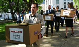 Democratic state representative Chris Sgro leads a group carrying petitions calling for the repeal of HB2 to governor Pat McCrory's office in Raleigh, North Carolina.