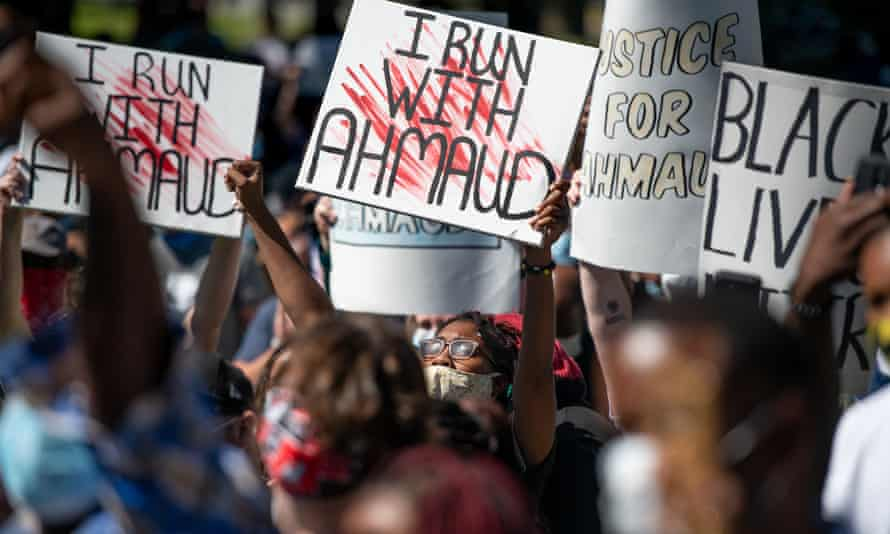 Demonstrators protest the shooting death of Ahmaud Arbery at the Glynn county courthouse on 8 May.