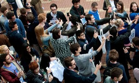Students taking selfies