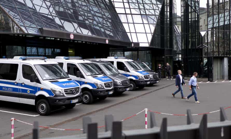 Police officers outside Deutsche Bank headquarters