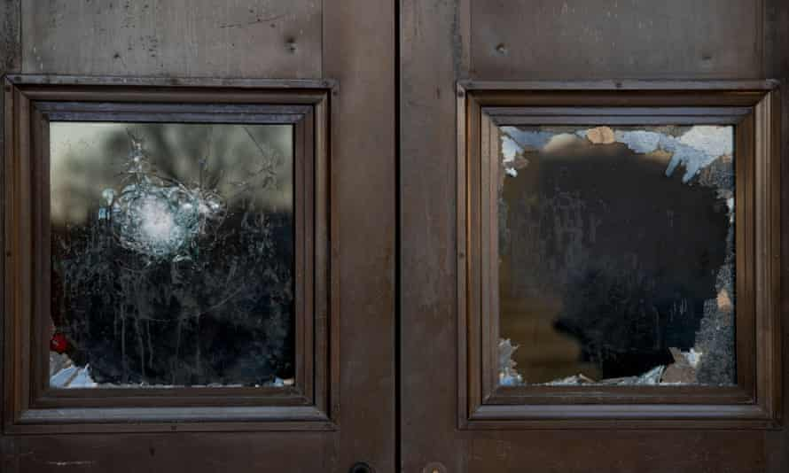 Broken windows on the front door of the US Capitol after a riot by pro-Trump supporters who stormed and vandalized the building.