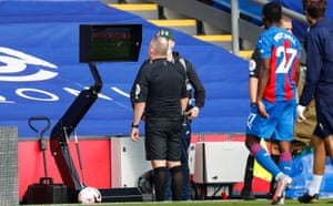 Jon Moss studies the monitor on the advice of VAR and turns the dismissal of Kyle Walker-Peters into a yellow card