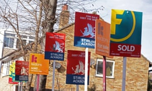 A row of sold, for sale and let by signs displayed outside houses.