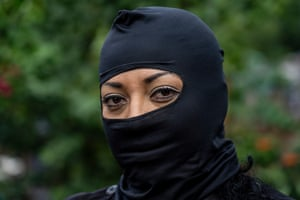 Marta, 52, a police officer in Chapeltique, wears a balaclava for fear of gang reprisals.