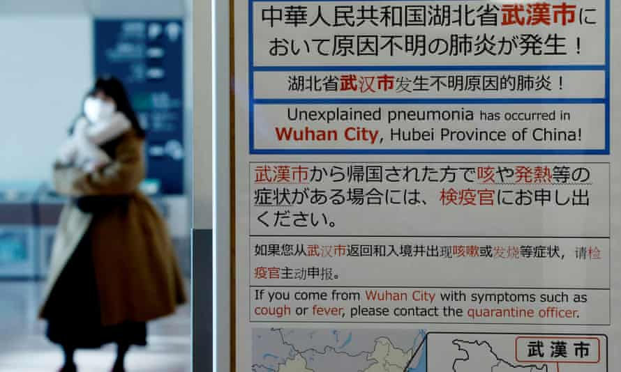 A quarantine notice about the outbreak of the coronavirus in Wuhan at an arrivals hall at Haneda airport in Tokyo, Japan.