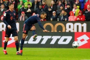Bayern Munich's Thiago thumps home their third goal.