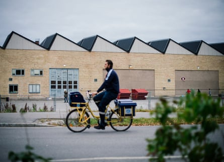 A postman rides his bike outside the Sundbyberg facility.