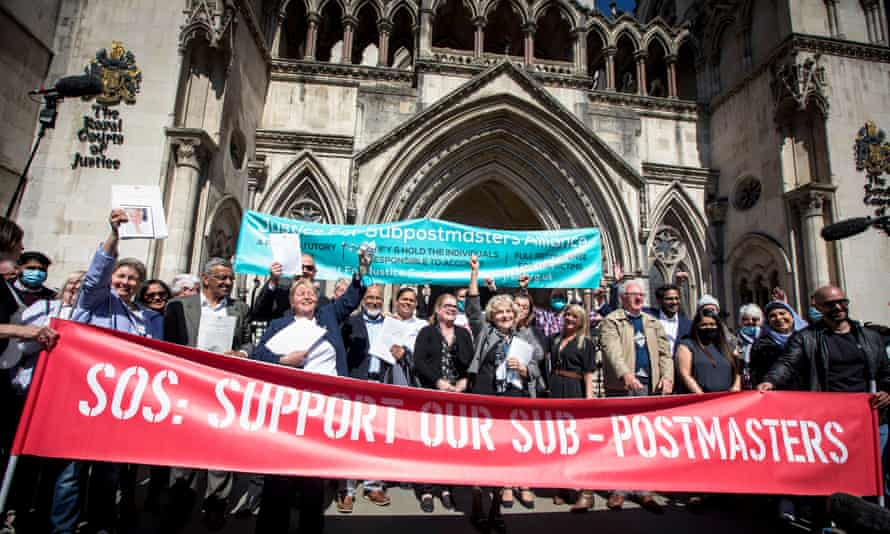 Some of the 39 subpostmasters celebrate outside the Royal Courts of Justice, London, with family and friends