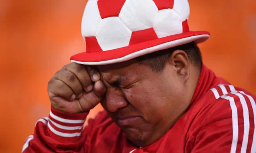 A tearful Peru fan after the defeat to France