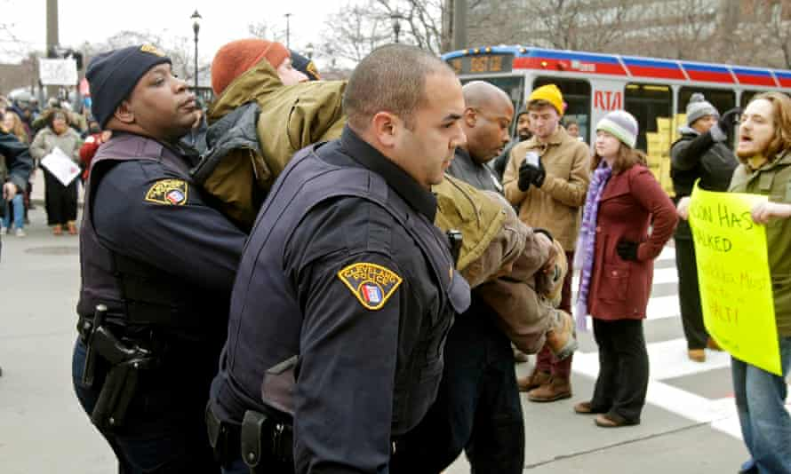 Police arrest a demonstrator protesting against the death of Tamir Rice in Cleveland.