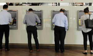 People withdraw money ATMs