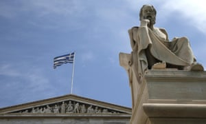 A marble statue of Socrates in front of the Athens Academy.