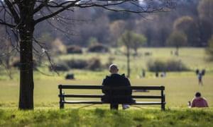 Man sitting on a bench in Regent's Park, London