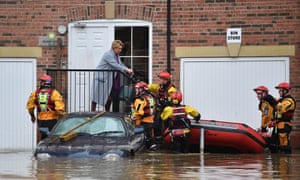 Rescue teams evacuate residents in the Huntington Road area of York after the River Foss burst its banks, on 28 December 2015.