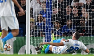 Zenit St. Petersburg's Artem Dzyuba (right) collides with Chelsea's keeper Edouard Mendy after sending the ball the wrong side of the upright.