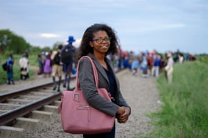 Panashe Chabwera, student lecturer at a local college, waits to board the train