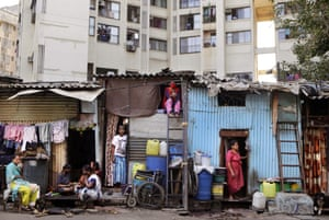 People in Dharavi, India's largest slum, are seen outside their homes during the lockdown to prevent the spread of the coronavirus in Mumbai.