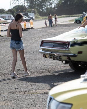 A fan checks out the cars at Melbourne Raceway.