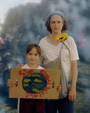 """Stella Grossenbacher, 9, and Danielle Rembert, 48, pose for a portrait at the Climate Strike NYC protest, part of a worldwide day of protests to bring attention to climate change. What scares you most about climate change? Danielle: """"Plastic. Plastic is something that never disappears. Almost everything else is biodegradable. Plastic breaks into small pieces. It gets into our body. It destroys the ecosystem of the world. I fear plastic more than the heat because I can visualize it. Why are you marching? Danielle: """"Because we know it's a very urgent problem. I don't think marching solves the problem but it gives you energy and a sense of community. I don't think it will change anything fundamentally. If everyone does something little every day that can help more than marching."""""""