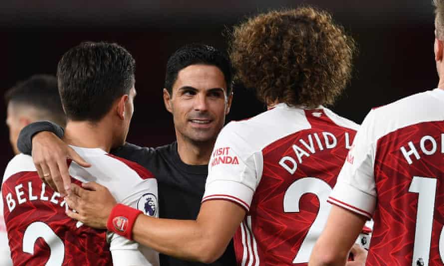 Mikel Arteta hugs Hector Bellerín and David Luiz after the scruffy win against West Ham.