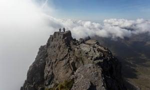 Climbers on the summit of Sgurr nan Gillean, Isle of Skye, Scotland.