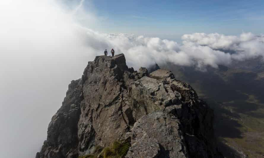 Climbers on the summit of Sgurr nan Gillean, Isle of Skye, Scotland.